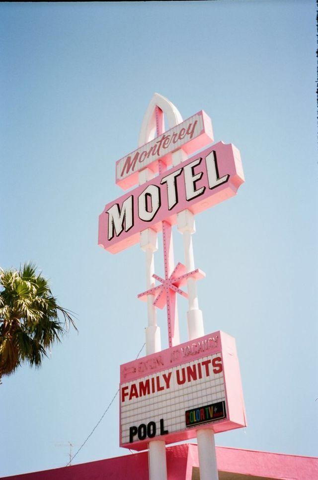Pastel pink mid century modern hotel signage