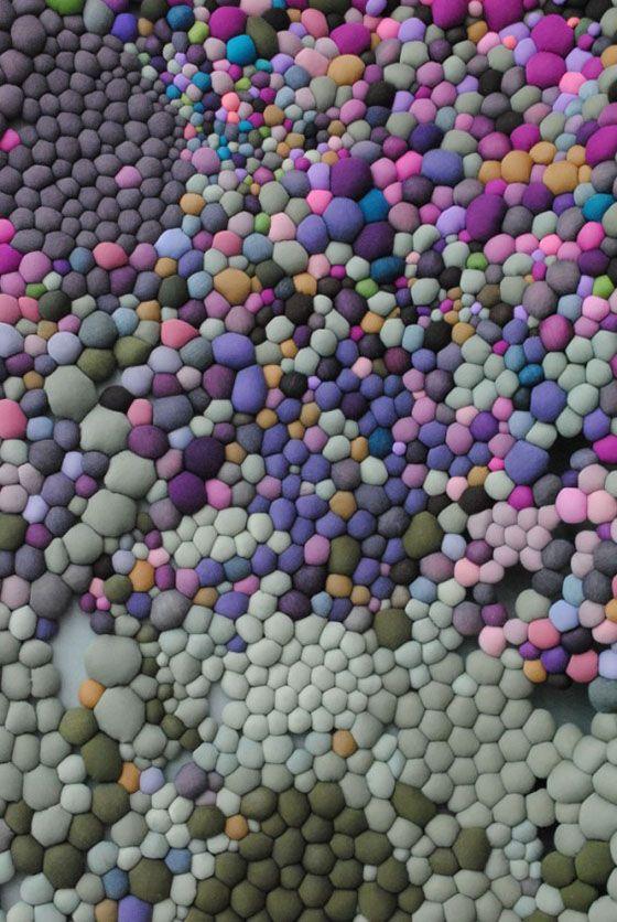 Chilean artist Serena Garcia Dalla Venezia creates stunning textile art from small handmade fabric balls that she then groups together.
