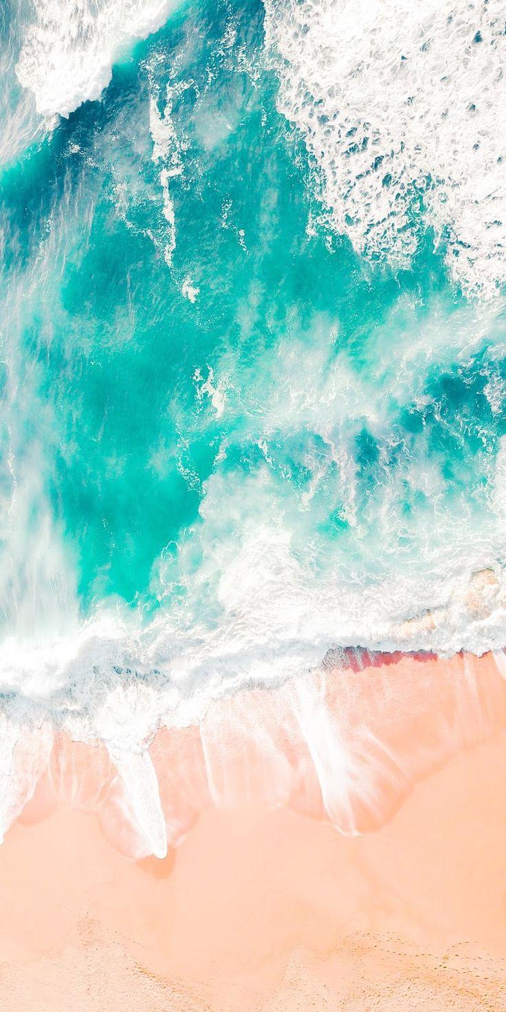 Rough ocean washing on sand shore in California