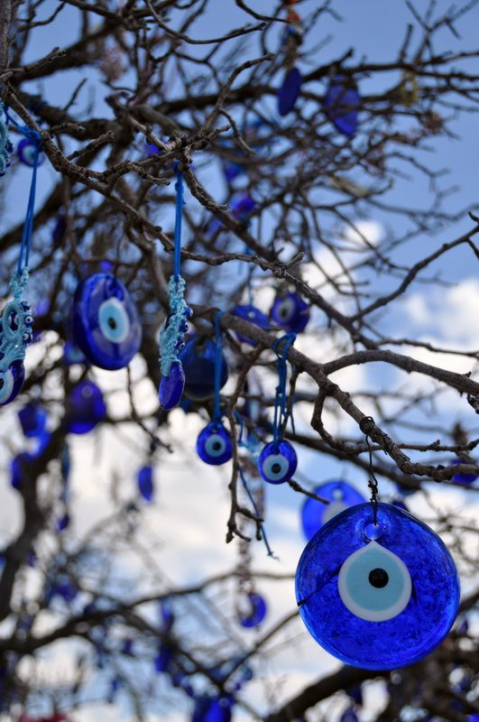 """the tree of evil eyes - Goreme, Nevsehir-Turkey *** by atanemli I this tree full of evil eyes(""""nazar boncugu"""" in turkish) which are believed to save people is located in pigeon valley, Goreme, Cappadocia I"""