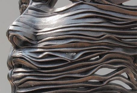22 Creative Human Figure Metal Sculptures Composed of Unraveling Steel Ribbons by Gil Bruvel