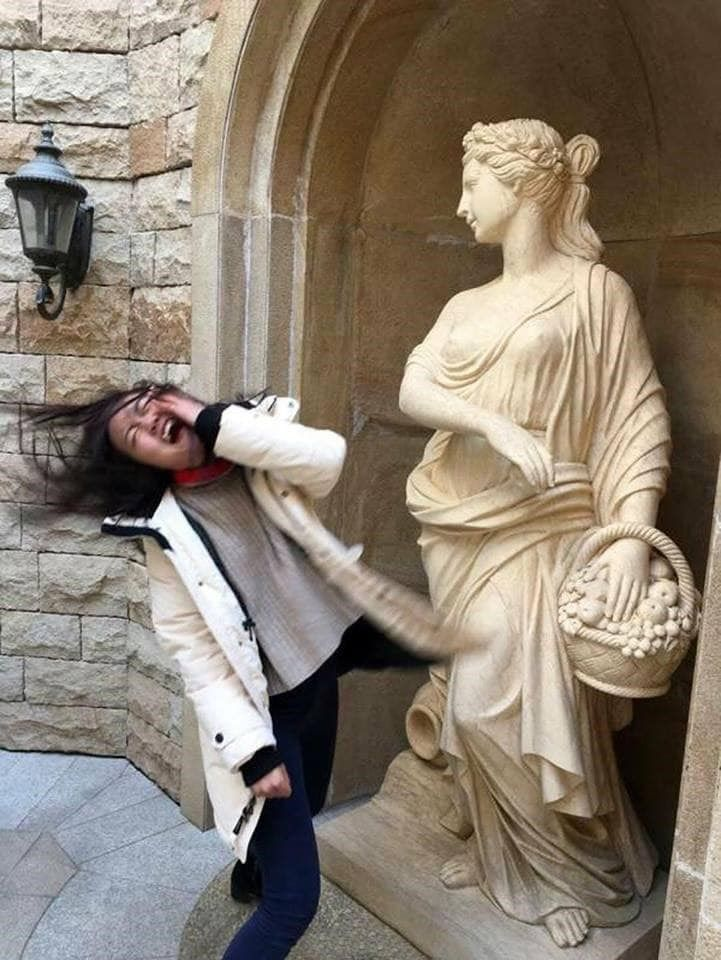Where you may see an enduring testament to history and the enduring human spirit, another person sees an amazing opportunity to make a statue look like he's kicking him in the crotch. #statues #funny #pictures