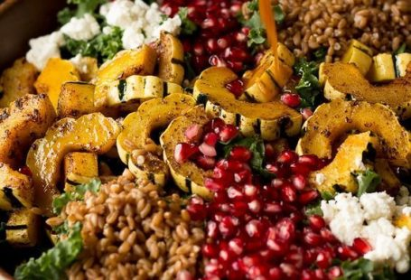 This Autumn Harvest Salad uses the beautiful produce available as the months start to get colder, such as delicata squash, kale, and pomegranates, as well as farro and goat cheese to make a hearty cold weather salad. Then it is all tossed together with a maple apple cider vinaigrette! #ad