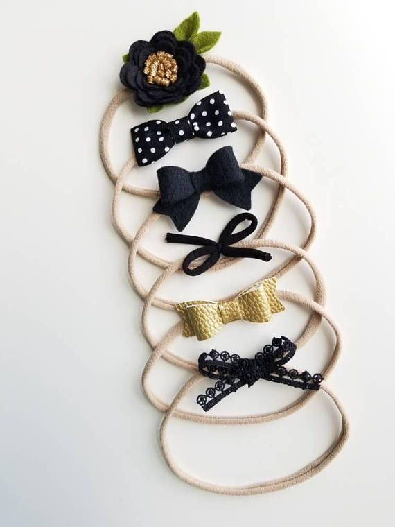 Beautiful Set of 6 Bows Handmade with faux Leather and wool felt in Neutral colors. Your baby girl will be so comfy with them, they will become your go to everywhere bows, You will be amazed with our Signature Nylon band, so soft doesnt leave any marks on your princess. ONE SIZE FITS