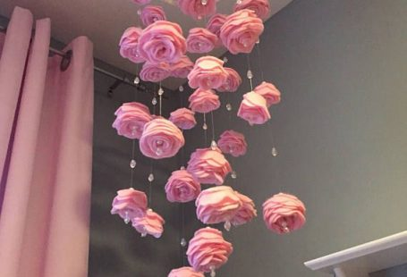 Handmade felt roses baby nursery mobile with crystals as water drops. Pearl accents, fishing wire creates a beautiful illusion. The ring is wrapped in ivory ribbon and there is a key ring on top to easily hang from a screw in hook (included). I make these as theyre ordered and theyll