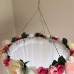 This beautiful hand crafted, floral canopy would be a gorgeous addition to a little girls room, above her bed or as a whimsical reading nook. Would also be perfect for a photography prop, in a bridal shoot or with a sweet newborn propped on a pile of soft blankets or pillows. The canopy drapes measure 98 long and hang from an additional 20 of twine, making the total length 118. The hoop has 110 of material gathered around it and measures 58 around and the measurement with the flowers is appro...