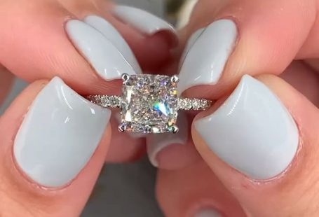 2 carat stunning cushion cut diamond engagement ring. Side stone hidden halo setting in white gold