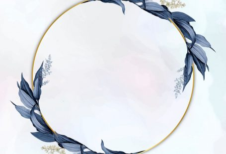 Gold circle frame decorated with blue leaves on a white paint brushstroke background