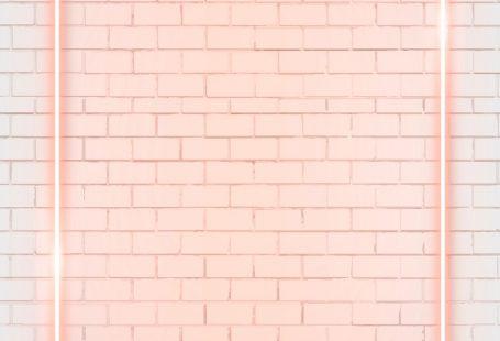 Rectangle orange neon frame on an orange brick wall vector