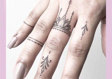 Frische und kreative Fingertattoos