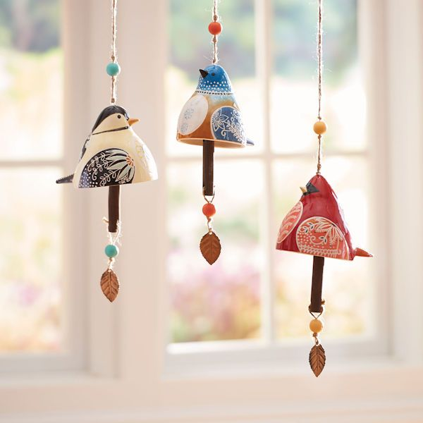 Hand-painted with vibrant colors, these ceramic bird bells are works of folk art. Suspended from a knotted jute cord accented with wood beads, finished with a clapper and metal feather, each comes with a special message of happiness and joy. Designed by American artist Lori Siebert, each 5
