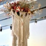 Fiber artist Lucy Lanuza teams up with Hana Floral Studio to create art for Boho Lifestyle shop in Napa. Come and see! #art #artinstallation #windowdisplay #visualmerchandising