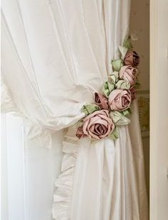 White curtains with flowers hanger