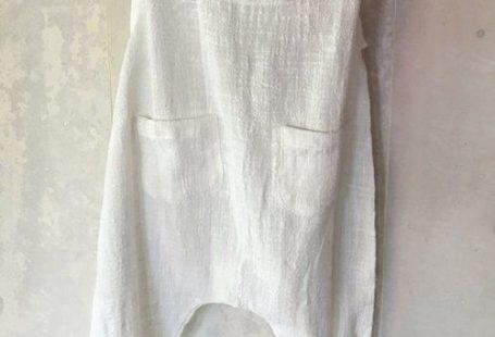 Pretty white boho baby romper in soft cotton or linen.