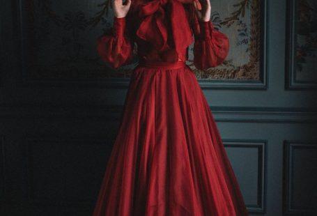 Red silk ballgown style alternative wedding dress separates by Joanne Fleming Design, dark and moody editorial image by David Wickham #joanneflemingdesign #reddress #redballgown
