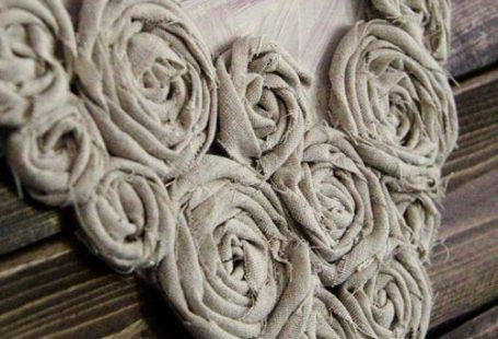 Hot glue fabric flowers into a heart shape