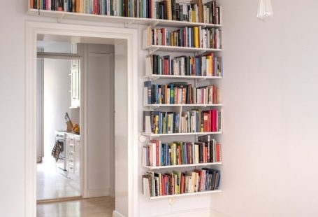 Great way to utilise space. Building open shelving around the door is a great way to maximise storage in a small space