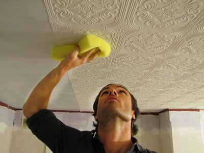 How to wallpaper your ceiling....I think beadboard style wallpaper would look great on a ceiling!