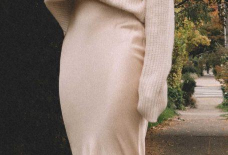 Sarah Butler of Sarah Roberts wearing fall chunky cream sweater and silk skirt in Seattle.