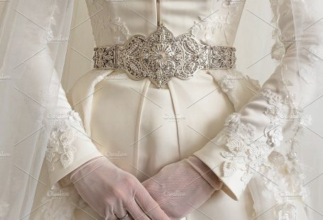 National costume of Caucasian bride. Close-up of a wedding dress. Wedding gown background. by Marmoset