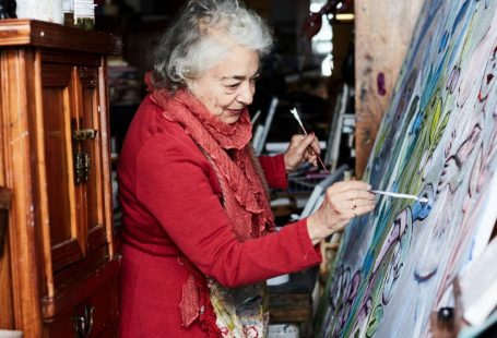 The Inimitable Mirka Mora in her studio painting - The Design Files